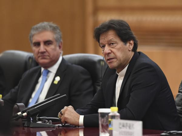 Pakistan's Prime Minister Imran Khan (right), shown here in April, will arrive in Washington, D.C., for a three-day visit that begins on July 21. His meeting with President Trump comes at a pivotal time for Afghan peace negotiations.
