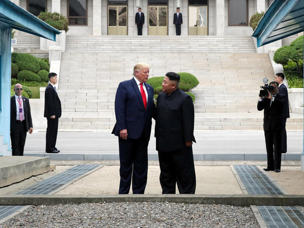 A handout photo provided by Dong-A Ilbo of North Korean leader Kim Jong Un and President Trump inside the demilitarized zone separating South and North Korea on June 30.