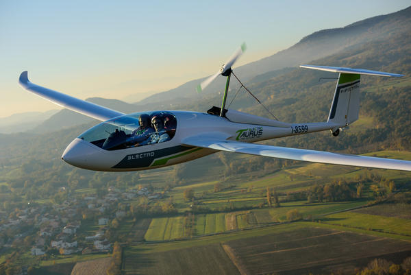 A Pipistrel Taurus Electro electric two-seat airplane flies above Ajdovscina, Slovenia.