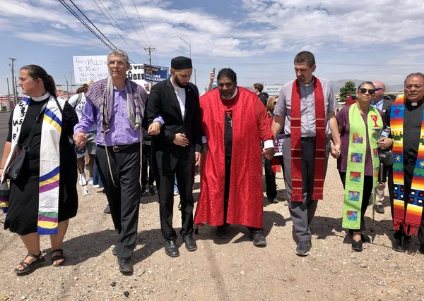 Religious leaders march to an Immigration and Customs Enforcement facility in El Paso.