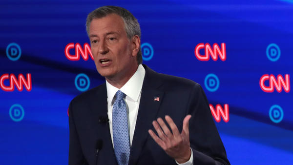 New York City Mayor Bill de Blasio speaks during the Democratic presidential debate in Detroit on Wednesday. Protesters disrupted the debate to criticize his handling of the officer involved in Eric Garner's death.