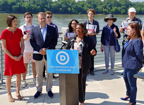 Ohio Democrats stand alongside the Ohio River hours before President Trump's rally at US Bank Arena.