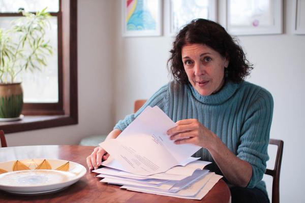 Cindy Hoedel, seen here in her Matfield Green home in 2017, looks through papers she gathered during her various protests of wastewater injection wells.