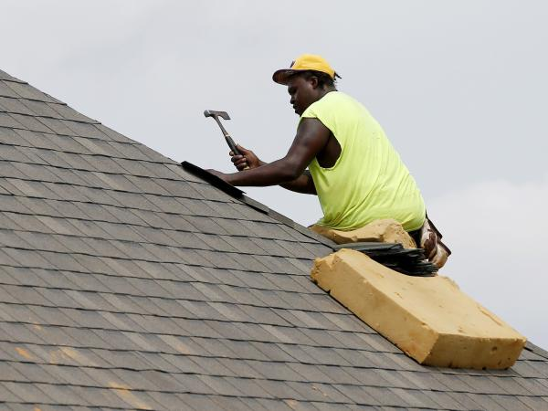 A construction worker lays down shingles on the roof of a new house in Brandon, Miss., on June 19. Construction jobs rose 4,000 in July — below the 18,000 added in June and the 19,000 added in July 2018.