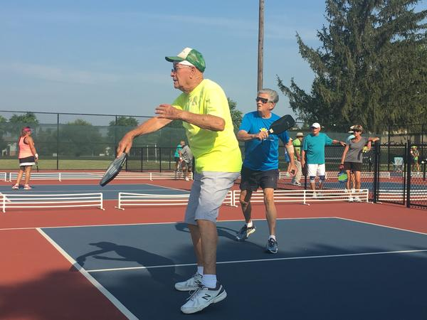 Eighty-nine-year-old Stanley Volkens (in yellow) and his playing partner, 86-year-old Bill Schaefer, work up a sweat on one of 16 pickleball courts at Lefferson Park.