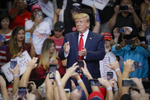 President Donald Trump arrives at a campaign rally at U.S. Bank Arena, Thursday, Aug. 1, 2019, in Cincinnati.