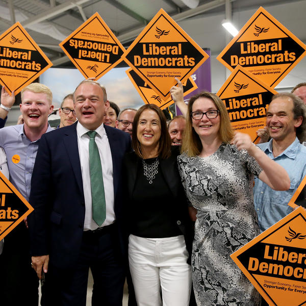 Liberal Democrat candidate Jane Dodds (center) celebrates her election victory with former Energy Secretary Ed Davey and Kirsty Williams, member of the Welsh Assembly, at Royal Welsh showground in Builth Wells, U.K., on Friday.