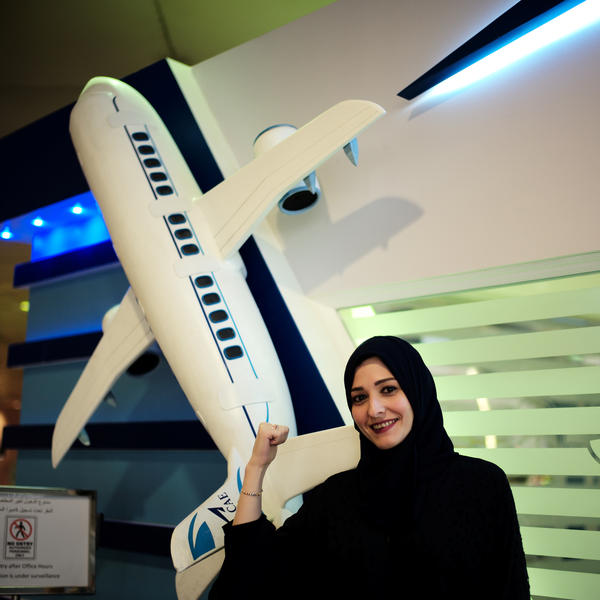 Dalia Yashar, one of the first Saudi students who registered to become a commercial pilot, stands in front of the registration center at King Fahd International Airport in Dammam, Saudi Arabia, last July. Recent decrees have expanded women's rights.