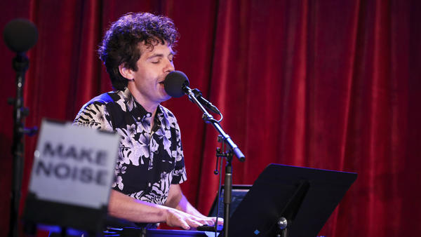 <em>Ask Me Another</em>'s guest house musician Julian Velard leads a music parody game at the Bell House in Brooklyn, New York.