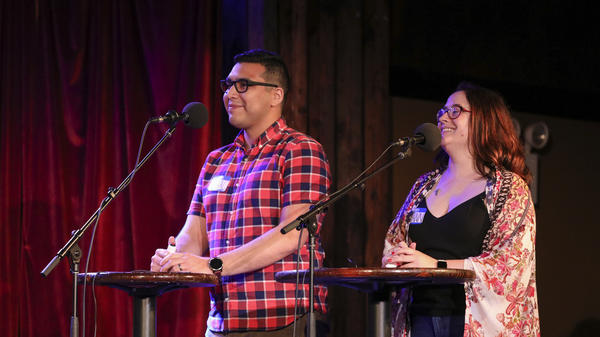 Contestants Isaac Villicana and Ryann Greenberg appear on <em>Ask Me Anothe</em>r at the Bell House in Brooklyn, New York.