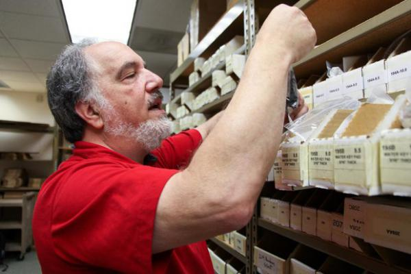 <p>Ed Kraus looks through inventory at Kraus Music Products, his company in Clackamas County, Ore., July 19, 2019. As a wholesaler, he doesn't collect retail sales tax, but he's still affected by the sea-change in tax laws.</p>