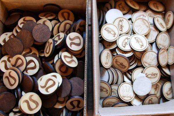 <p>An example of the laser-engraved wooden tokens Toasted Maple makes for clients like Lululemon from its workspace in The Dalles, Ore., July 18, 2019. Owner Lindsey Brady is paying for software to stay compliant on other states' sales tax rules.</p>