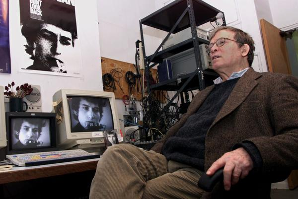 Documentary filmmaker D.A. Pennebaker sits near an editing station showing images of singer-songwriter Bob Dylan on Thursday, Jan. 27, 2000. Pennebaker, who died on Aug. 1, is most famous for his film <em>Don't Look Back,</em> a critically acclaimed chronicle of Dylan's three-week 1965 British tour.