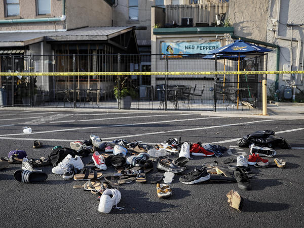 Shoes of victims are piled at the scene of Sunday's mass shooting in Dayton, Ohio.