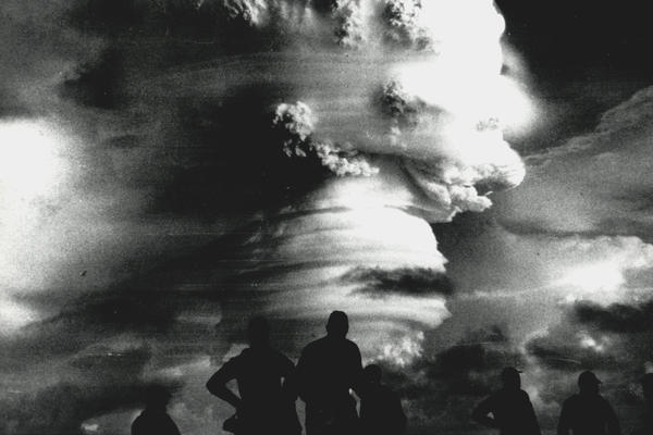 Observers watch an explosion during Operation Hardtack in 1958. 35 nuclear tests were conducted in the Pacific, exposing troops to radiation.
