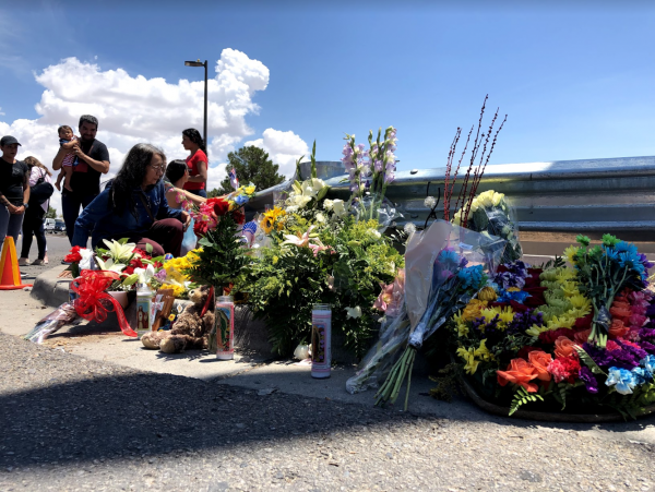 Community members leave flowers and other gifts to honor the lives lost in the El Paso shooting.