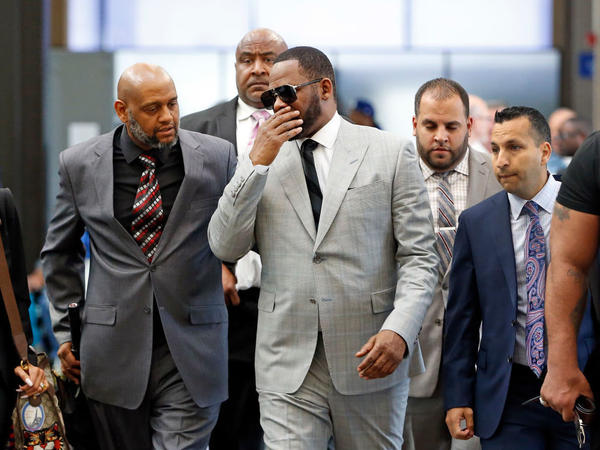 R. Kelly arrives in court in Chicago in June 2019. On Monday, Hennepin County, Minn. announced two criminal charges against the singer.