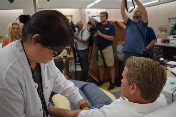 Lt. Gov. Jon Husted was among those giving blood on Monday at Community Blood Center in Dayton.