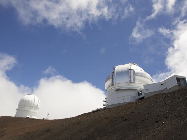 The Gemini Telescope (right) and Canada-France-Hawaii Telescope on Hawaii's Mauna Kea near Hilo, Hawaii.