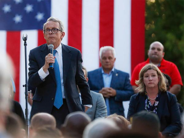 Ohio Gov. Mike DeWine, left, speaks alongside Dayton Mayor Nan Whaley, right, during a vigil at the scene of a mass shooting, Sunday, Aug. 4, 2019, in Dayton.