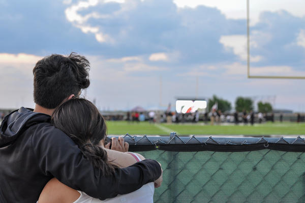 Two El Paso community members embrace at a vigil remembering Javier Rodriguez, who died in the mass shooting on Saturday Aug. 3.