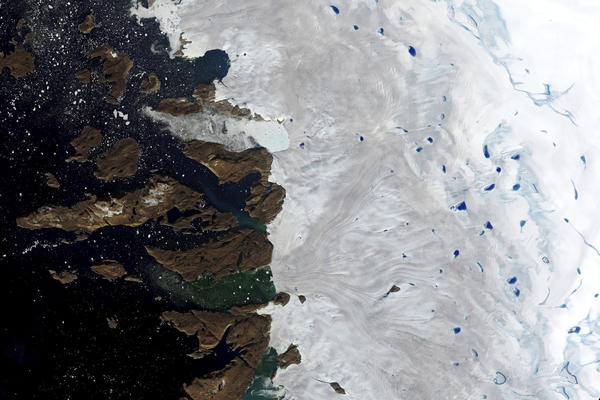 This July 30, 2019, natural-color image made with the Operational Land Imager (OLI) on the Landsat 8 satellite shows meltwater ponding on the surface of the ice sheet in northwest Greenland near the sheet's edge. (NASA via AP)
