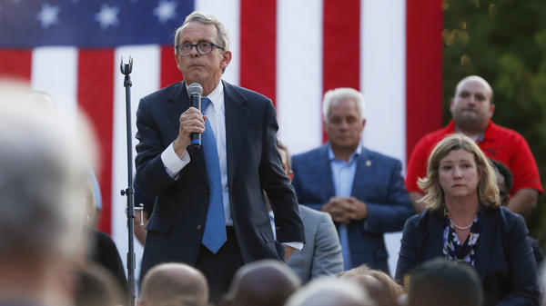 Ohio Gov. Mike DeWine (left) spoke alongside Dayton Mayor Nan Whaley during a vigil at the scene of a mass shooting in that city on Sunday.