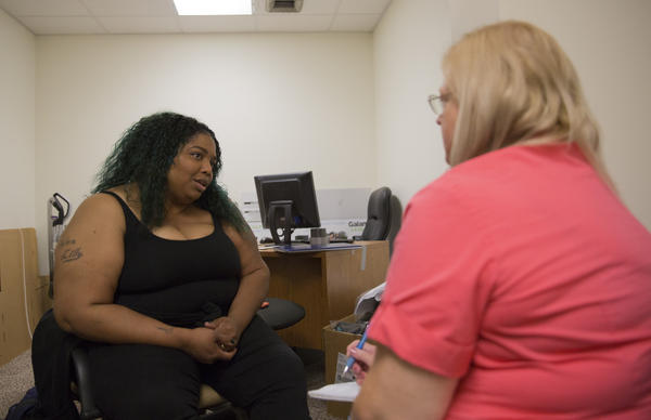 Peer support specialist Sheri Hall (left) gives advice to Susan Haynes. Hall doesn't have a degree in social work or psychology, but she and Haynes bond over their Christian faith, love of writing and shared history of anxiety.
