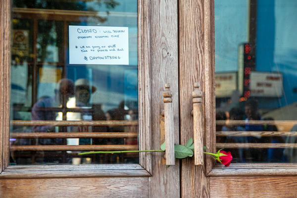 A note on the door of Ned Peppers Bar in Dayton, Ohio, near the site of the Aug. 4 shooting.