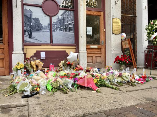 Flowers and candles in front of Ned Peppers Bar memorialize victims of the Oregon District mass shooting.