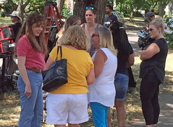 """Amy Adams (left) talks to a group of women during a break in shooting """"Hillbilly Elegy"""" Wednesday."""