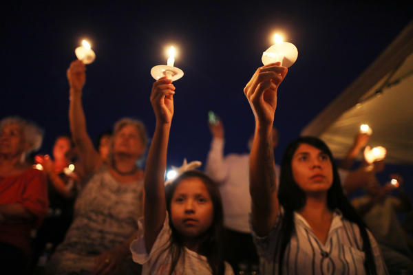 A candlelight vigil held for shooting victims in El Paso.
