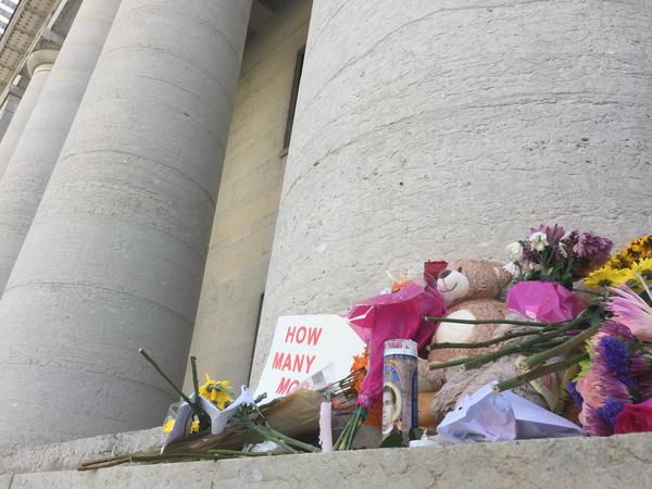 "A memorial was left on the steps of the Ohio Statehouse to honor the victims killed in the mass shooting in Dayton on Sunday with a sign that read ""How Many More?"""
