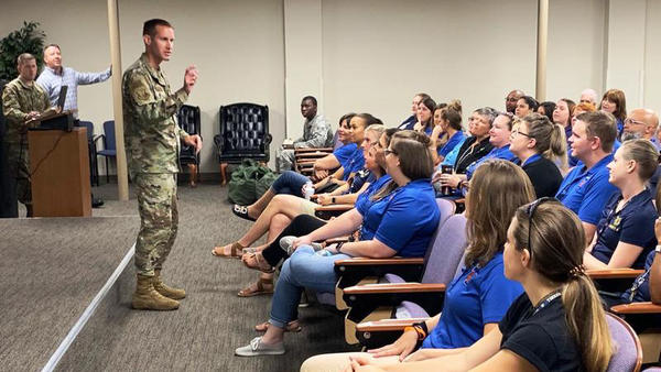 MacDill Air Force Base Commander Col. Stephen Snelson addressed teachers who work at Tinker K-8 on base during an orientation program about military culture.