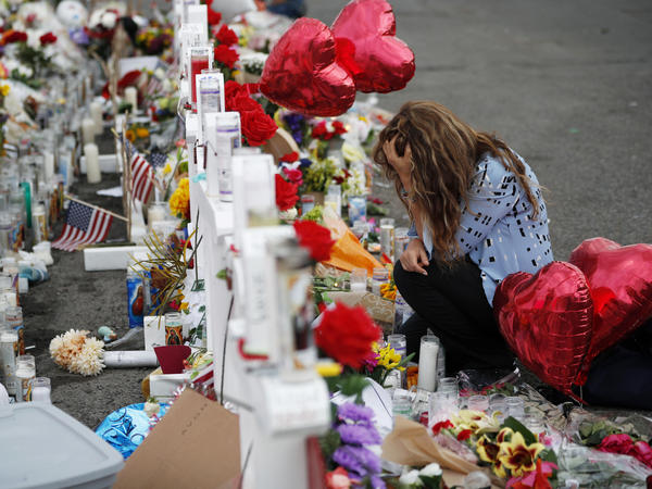 Mourners gather at memorial crosses near the scene of a mass shooting at an El Paso, Texas, Walmart on Aug. 3.