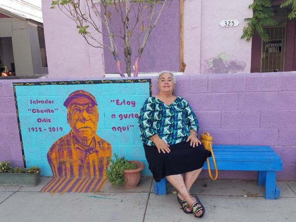 Chicana historian Yolanda Chavez Leyva sits outside one of the remaining homes in Duranguito, one of El Paso's oldest neighborhoods.