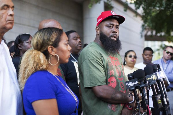 Michael Brown Sr. holds a press conference Friday on the fifth anniversary of his son's shooting death.