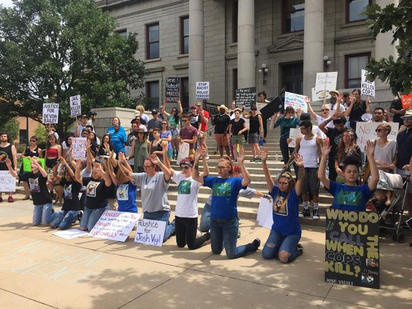 Protestors demonstrate against police brutality on the steps of City Hall