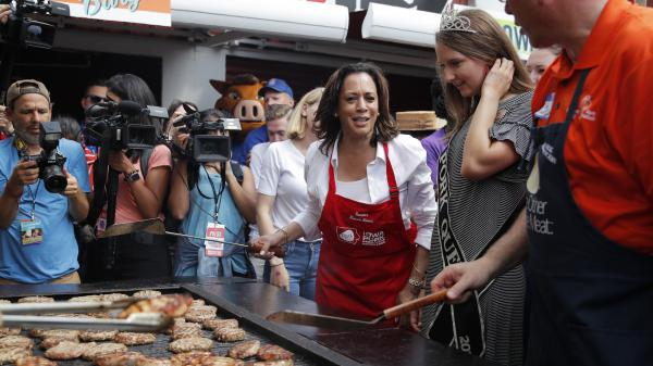 Democratic presidential candidate Kamala Harris flips pork chops at the Iowa State Fair on Saturday. She came to the fair intent on proving she's a top-tier contender.