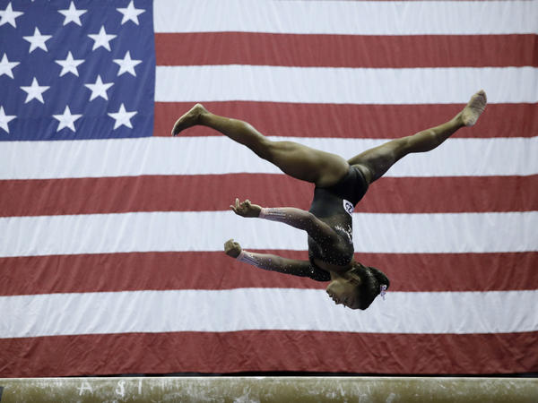 Simone Biles competes on the balance beam at the U.S. Gymnastics Championships on Sunday. The reigning world champion is the first woman to stick the landing after two flips and three full twists.