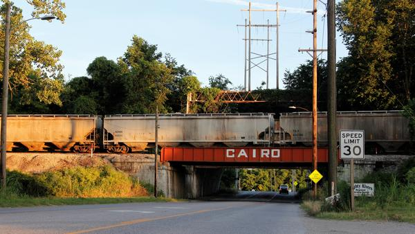 Driving into Cairo, Ill., from the north, you pass a funeral home and go through an underpass beneath a rail line. Structures behind this bridge block road traffic through the underpass in case of massive flooding from the nearby Ohio and Mississippi rivers.