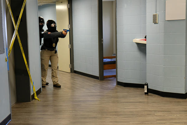 A police officer tells a role-playing trainer to drop his weapon in Roskey Hall Dormitory at MSU's Campus in Bozeman, Montana, August 08, 2019.