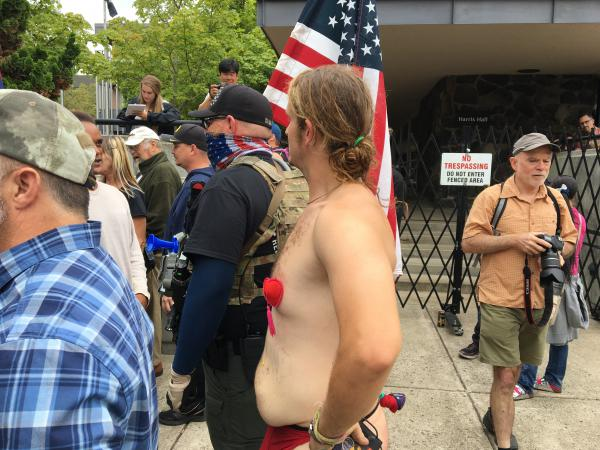 This scantily clad counter protestor attempted to deescalate confrontations by dancing around attendees.