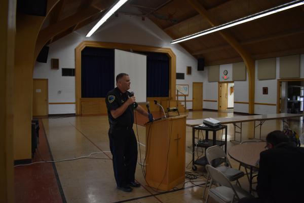 Peoria Police Assistant Chief Michael Mushinksy provides an East Bluff policing update at First English Lutheran Church, 8/12/19