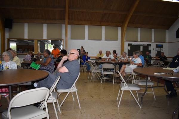 Concerned East Bluff neighbors gather at First English Lutheran Church for a policing update.