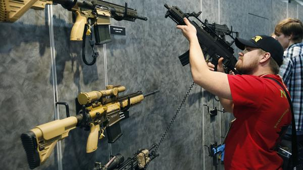 A visitor perused H&K rifles at the SHOT Show in Las Vegas. Such weapons were once restricted under a 1994 ban that expired with changing politics in the United States. Would Democrats revive it?