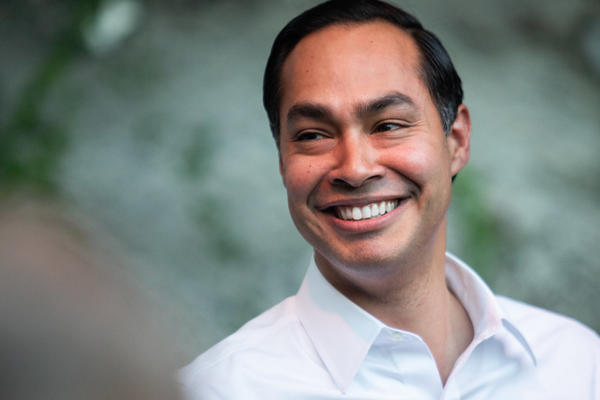 Former San Antonio Mayor Julián Castro smiles at supporters during a campaign rally at Cheer Up Charlies in June.