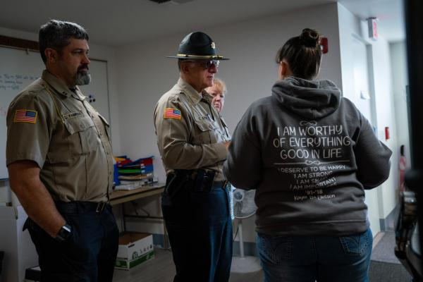 Coos County Sheriff Craig Zanni, center, speaks with Sheriff Department dispatchers on June 6, 2019, in Coquille, Oregon.
