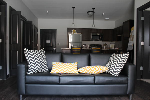 Wichita State University's The Flats apartments have full kitchens and come furnished.