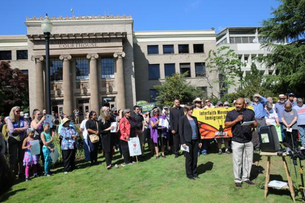 <p>Isidro Andrade Tafolla, who was briefly detained by ICE outside the Washington County Courthouse in 2017, spoke to a crowd gathered outside the courthouse&nbsp;on Monday.&nbsp;</p>